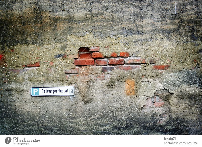 Wall (barrier) Signs and labeling Derelict Brick Parking Parking lot Rent Old fashioned