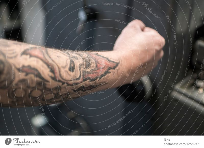 Human being Masculine Arm Technology Tattoo Workplace Effort Fist Death's head Pushing Printing Print shop Printer Printing machine Switch lever
