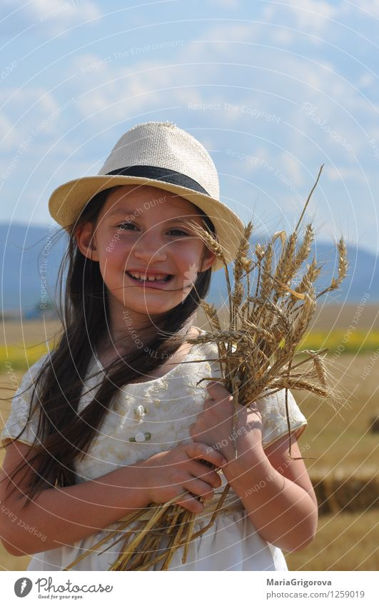 smiling little girl holding wheat in hands Human being Child Nature Plant Beautiful Summer Sun Hand Landscape Girl Face Eyes Healthy Hair and hairstyles