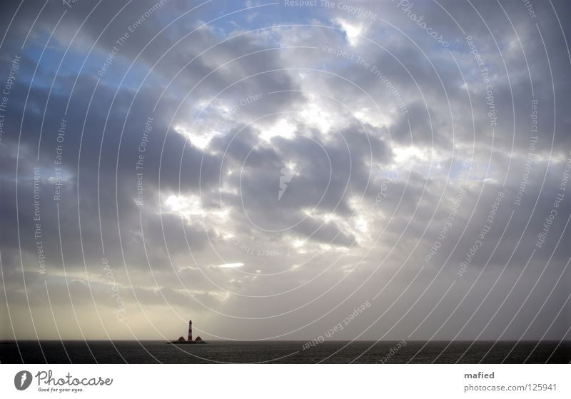 Water Sky Sun Ocean Clouds Loneliness Far-off places Waves Wind Threat Gale Lighthouse North Sea Schleswig-Holstein High tide Dike