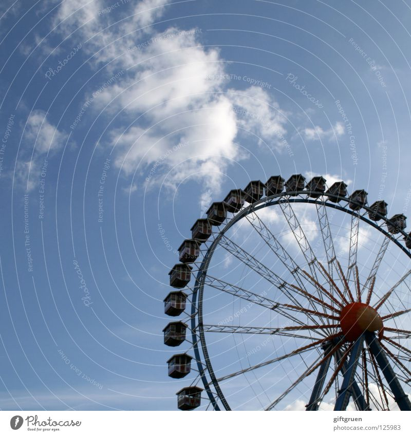 Ferris wheel Round Fairs & Carnivals Theme-park rides Carousel Rotate Large Attraction Joy Playing Leisure and hobbies Sky Level Tall all around Vertigo