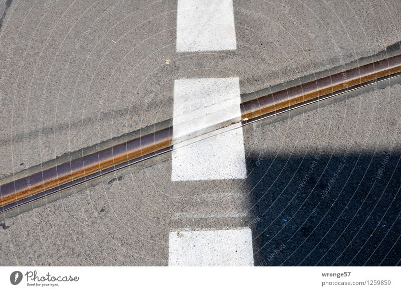City White Black Street Gray Line Brown Signs and labeling Stripe Railroad tracks Traffic infrastructure Pavement Road junction Cross Lined Marker line
