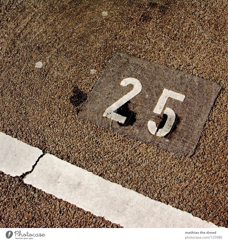 25 Parking lot Digits and numbers Tar White Minimal Transport Twenties Places Hard Cold Physics Traffic infrastructure Street sign Line Contrast Crazy