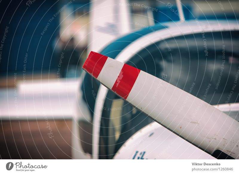 Propeller aircraft with two red stripes Design Vacation & Travel Industry Technology Art Exhibition Air Airport Transport Vehicle Airplane Aircraft Blue Red