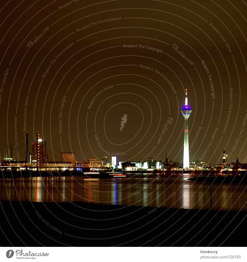 skyline chase Rheinturm Town Lifestyle Night life Transmit Transmitting station Long exposure Exposure Duesseldorf Modern Bridge Rhine Evening Street Blue