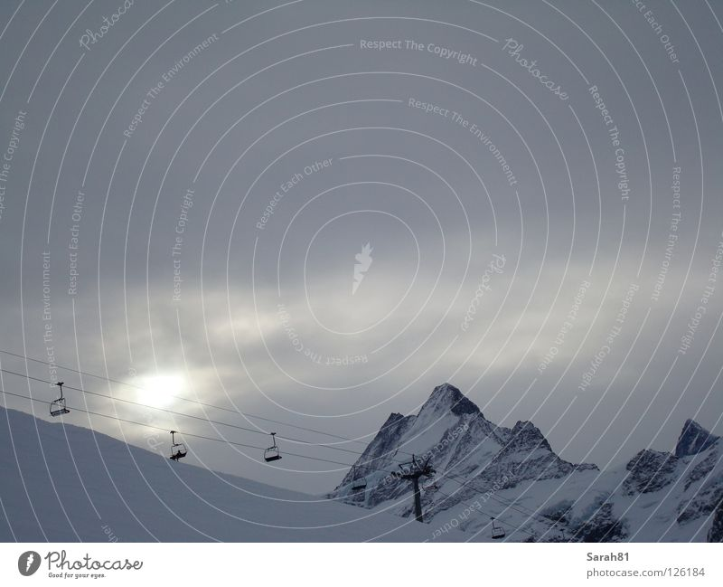Last ascent Winter Chair lift Bad weather Dark Sunset Loneliness Moody Grindelwald White Gray Driving Go up Cold Bernese Oberland Human being Derelict Playing