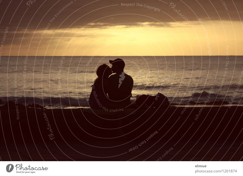 The goodnight kiss. Young woman Youth (Young adults) Young man Couple 2 Human being Water Sunrise Sunset Beach Kissing Romance Silhouette Lovers Dream Embrace