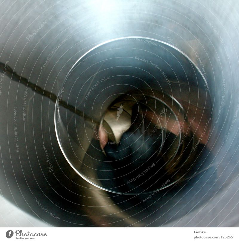 Journey to the center of the earth Slide Hard Tunnel Whirlpool Playground Playing Romp Time Light Longing Speed Simple Effort Joy Silver Metal Smoothness