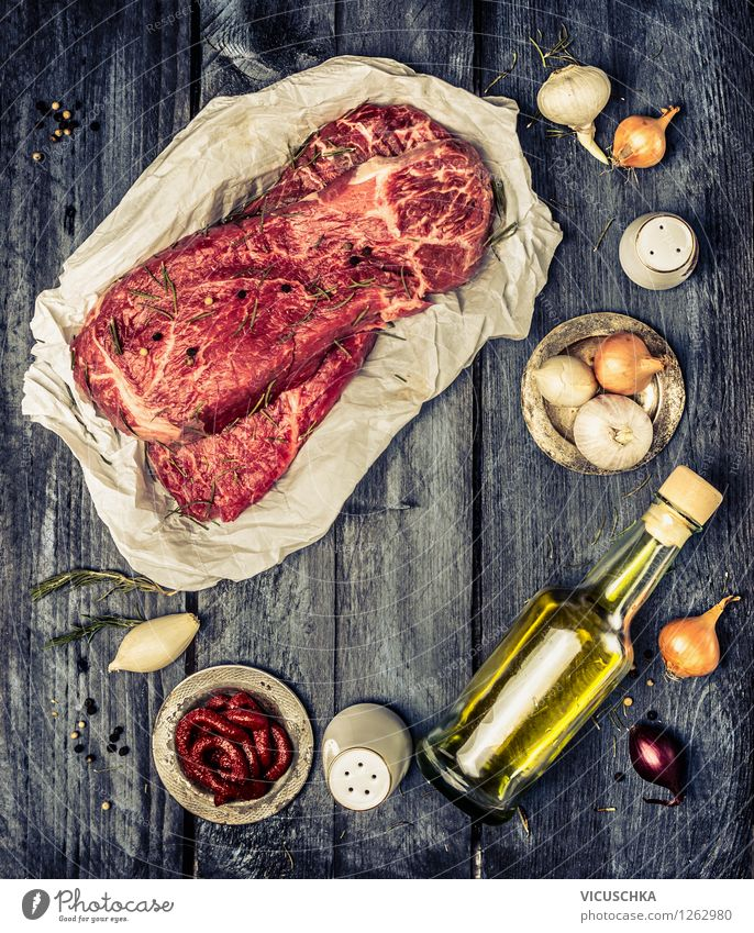 Marbled beef and cooking ingredients Food Meat Herbs and spices Cooking oil Lunch Dinner Organic produce Diet Bottle Style Design Healthy Eating Life Table