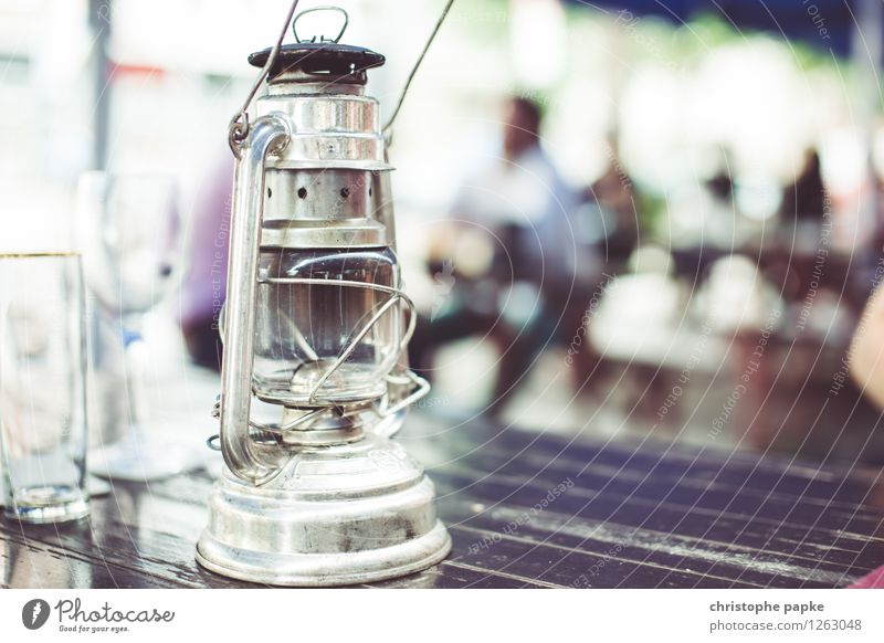 light source Decoration Lamp Old Historic Oil lamp gas lamp Beer garden Table Garden Colour photo Close-up Copy Space right Copy Space bottom Day