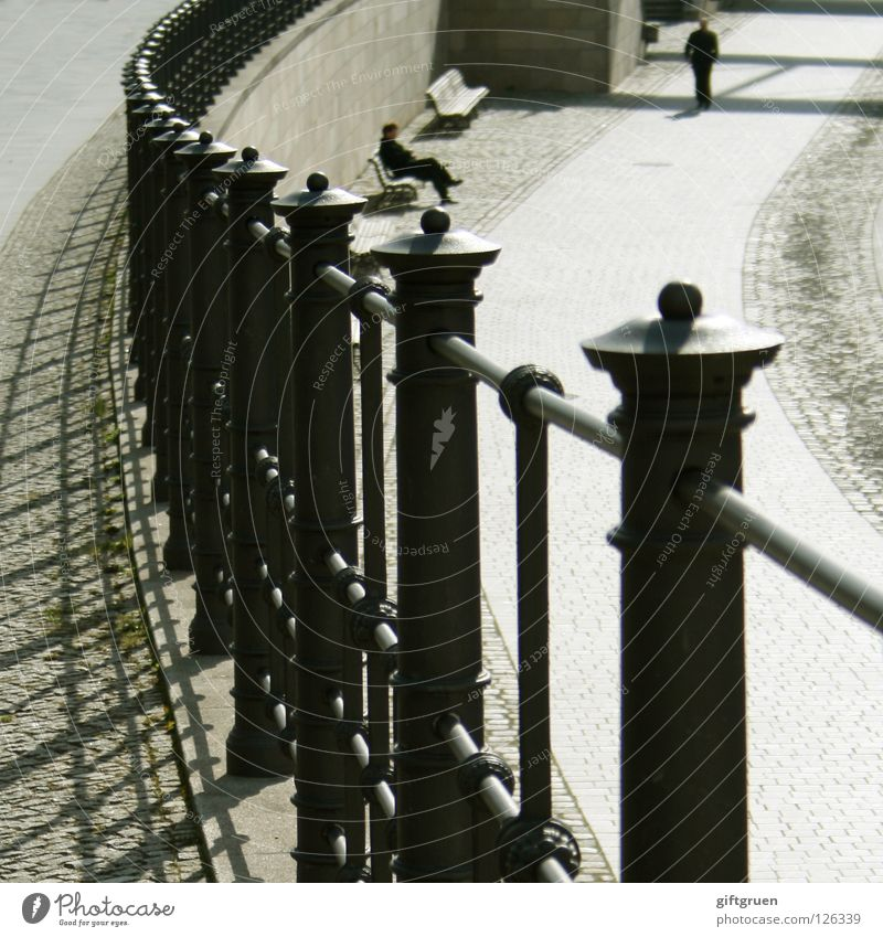 lunch break Lunch hour Fence Relaxation Midday sun To go for a walk Pedestrian Detail Success Man Shadow Sit Sun Bench