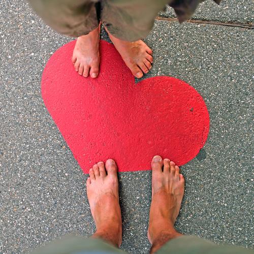 Heart and feet Human being Masculine Feminine Feet 30 - 45 years Adults 45 - 60 years Summer Pedestrian Street Sign Love Trust Safety (feeling of) Infatuation