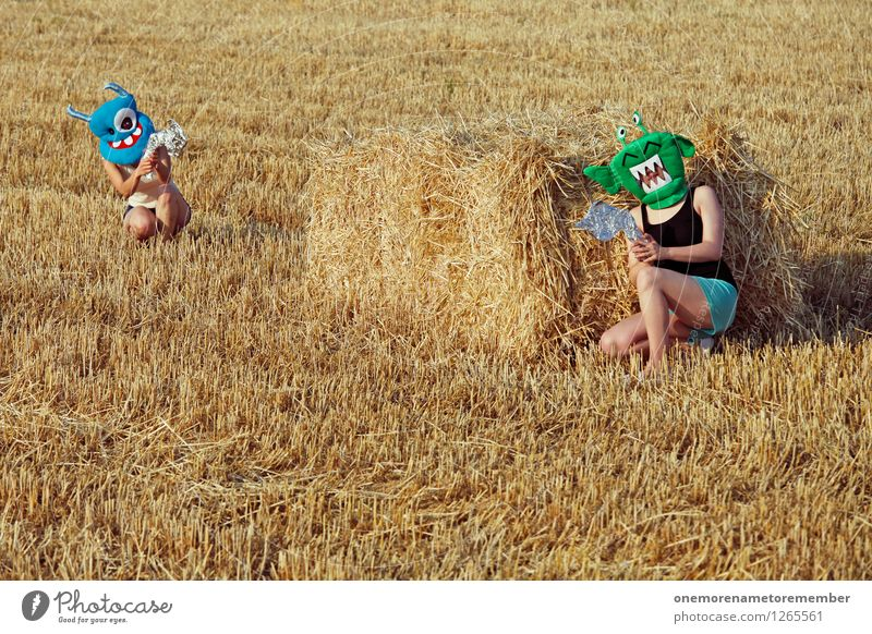 INCOMING! Art Work of art Esthetic Mask Playing Extraterrestrial being Monster Laser Weapon Fight Youth (Young adults) Youth culture Bale of straw Field