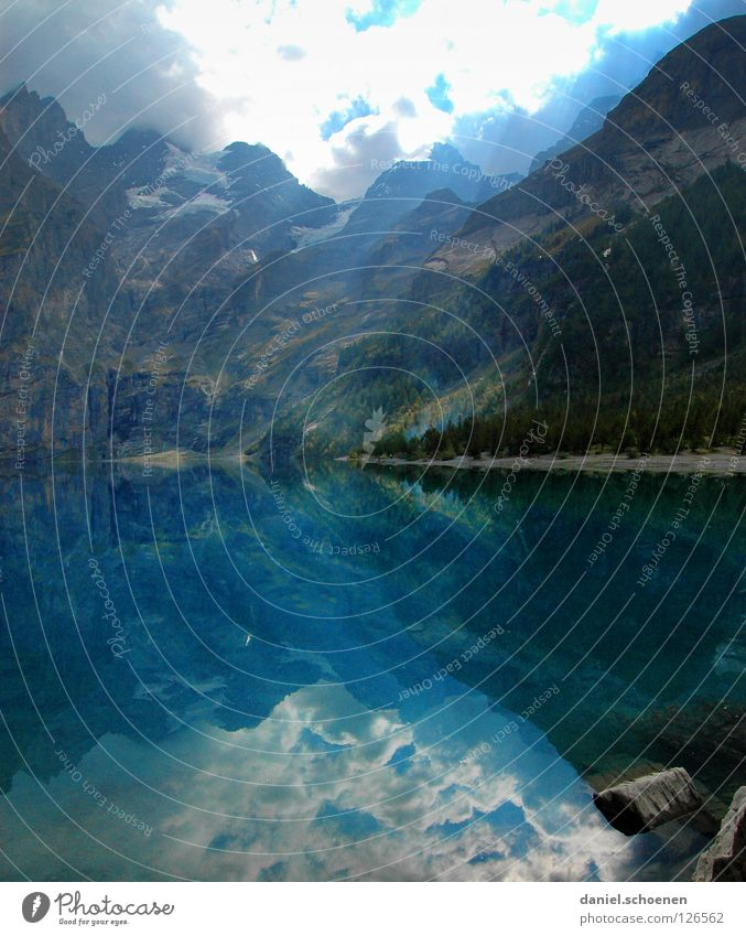 lake of mirrors Reflection Lake Switzerland Cyan Light Hiking Fir tree Green Summer Loneliness Calm Clouds Surface Sky Water Mountain Blue Sun Nature Alps Rock