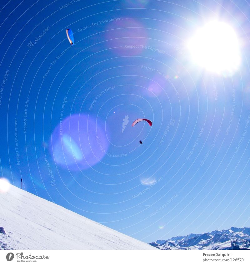 paraglider 4 Parachute Flying sports Reflection Paragliding Red Sunbeam Radiation Federal State of Tyrol White Westendorf Winter Austria Nature Sky Snow