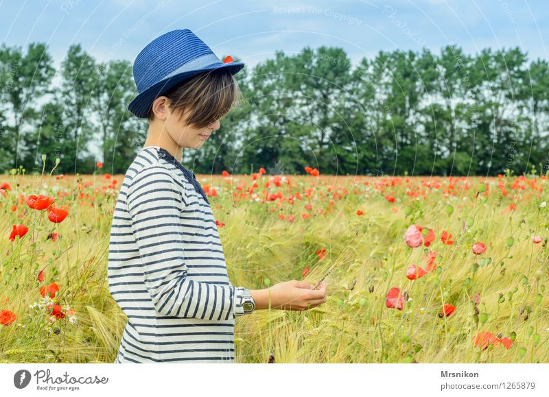 girl Feminine Child Girl Infancy Youth (Young adults) Life 1 Human being 8 - 13 years Looking Stand Hat Straw hat Girlish Portrait of a young girl Poppy