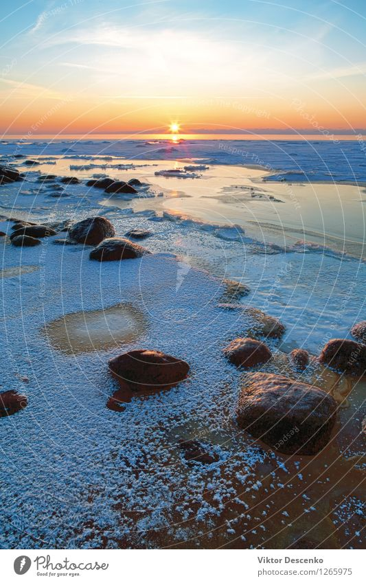 Sunset in the frozen sea with hoarfrost and stones Beautiful Relaxation Vacation & Travel Beach Ocean Winter Snow Nature Landscape Sand Sky Horizon Rock Coast
