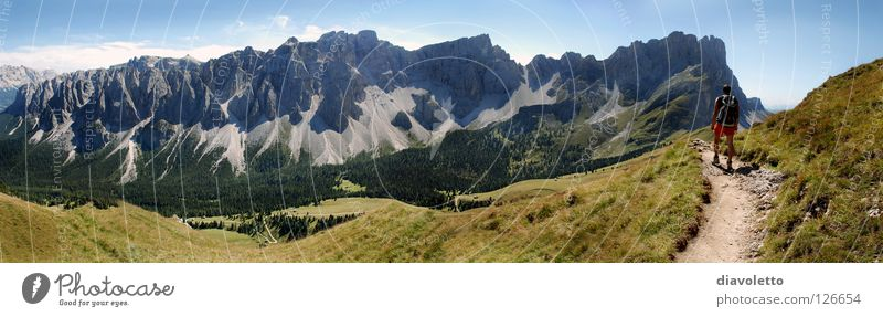 The mountain calls South Tyrol Mountain range Hiking Dolomites Backpack Panorama (View) Summer Hiking boots Federal State of Tyrol Footpath Meadow Grass Italy