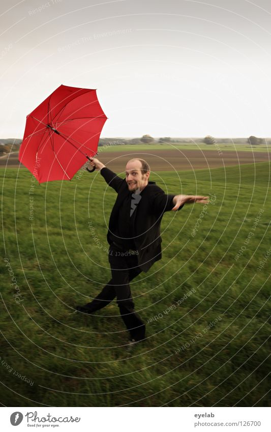 egg neck Man Umbrella Field Agriculture Meadow Plain Suit Green Red Black Fellow Grimace Acrobatics Art Horizon Circus Improvise Dance Playing Rural Going Jump