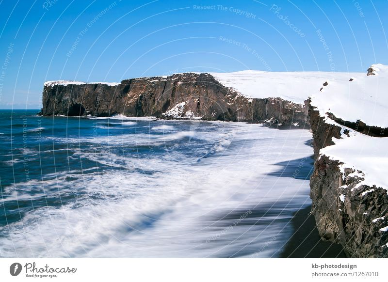 Peninsula Dyrhólaey in south Iceland with long time exposure Winter Environment Landscape Elements Cloudless sky Beautiful weather Snow Rock Volcano