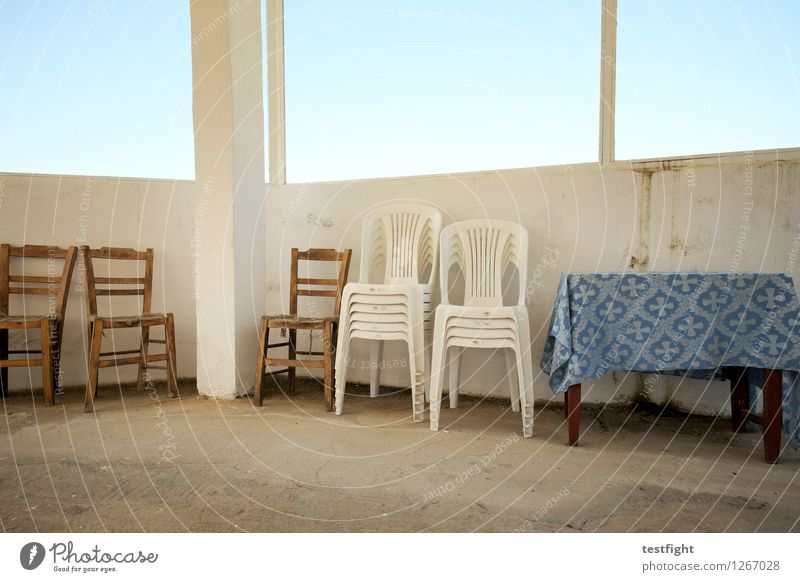 row of chairs with table Chair Table Wooden chair Plastic chair Stone Old Blue Calm Stagnating Tablecloth Window pane Colour photo Interior shot Morning Light