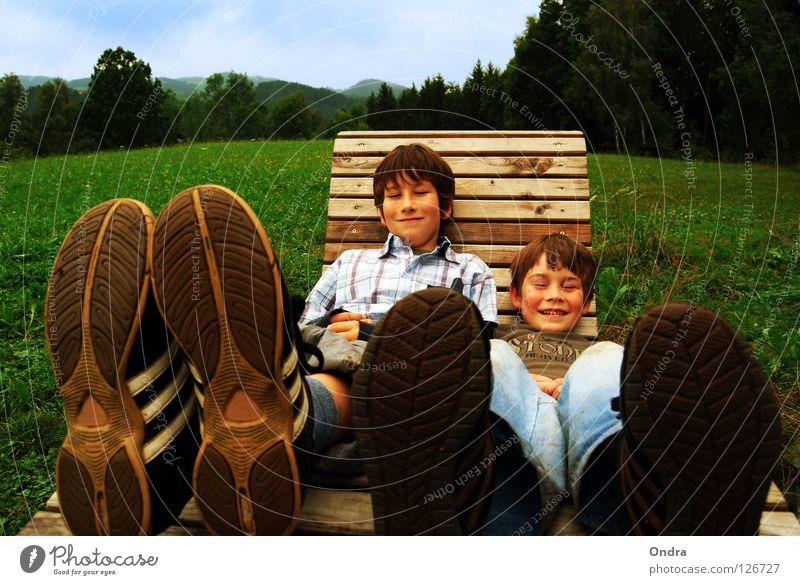 Life on big feet Clouds Meadow Child Boy (child) Masculine Tree Forest Green Environment Footwear Shoe sole Rocking chair Deckchair Happiness Summer Joy Sky