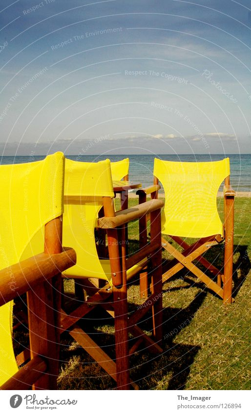 Silence and loneliness Summer Beach Ocean Relaxation Vacation & Travel Leisure and hobbies Yellow Calm Autumn Island Mediterranean sea Chair Water Camping chair