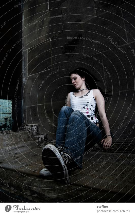 Woman Beautiful Relaxation Wall (building) Wall (barrier) Contentment Young woman Sit Floor covering Corner Jeans Club Boredom Motionless Attractive Prop