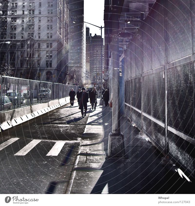 Human being Man Sun Moody Going Construction site Fence Stress Banquet Dazzle New York City Manhattan Haste Exhaustion Intersection Zebra crossing