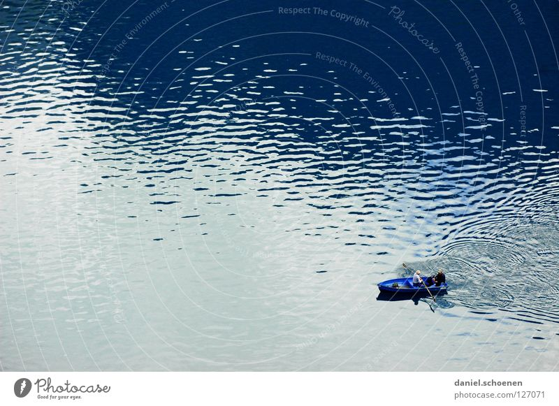 Angler's dream in blue Lake Watercraft Leisure and hobbies Fishing (Angle) Waves Background picture Pattern Rowing Rowboat Calm Loneliness Surface Mountain lake