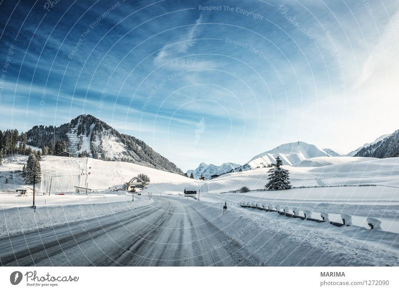 Winter landscape in the Alps Mountain Nature Landscape Transport Means of transport Traffic infrastructure Motoring Street Cold Blue White mountains hill