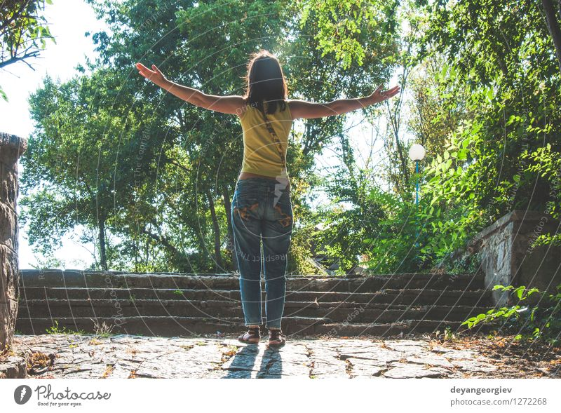 Woman with arms outstretched against sun Lifestyle Joy Happy Beautiful Relaxation Leisure and hobbies Freedom Summer Sun Girl Adults Arm Nature Sky Stand