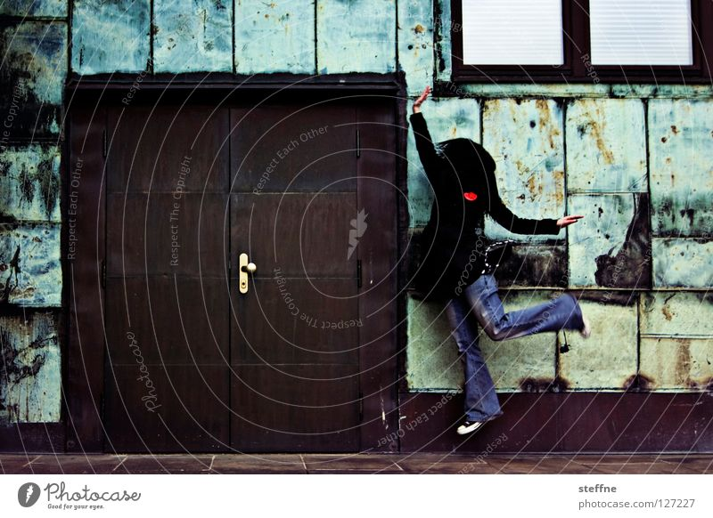 Woman Youth (Young adults) Green City Beautiful Wall (building) Playing Jump Wall (barrier) Door Brown Dance Happiness Sweet Jeans Industrial Photography