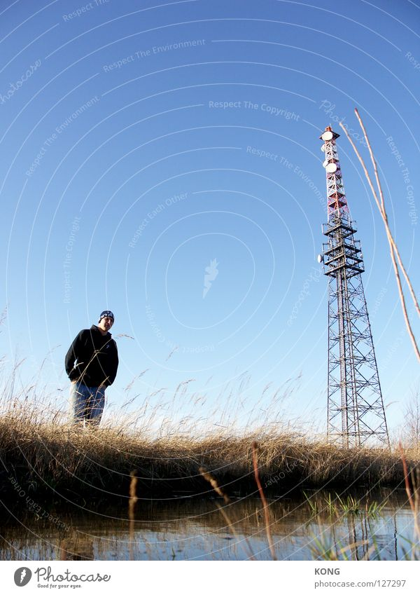 Man Sky Blue Loneliness Far-off places Meadow Coast Large Crazy Industry Technology Tower Long Upward Blade of grass Beautiful weather