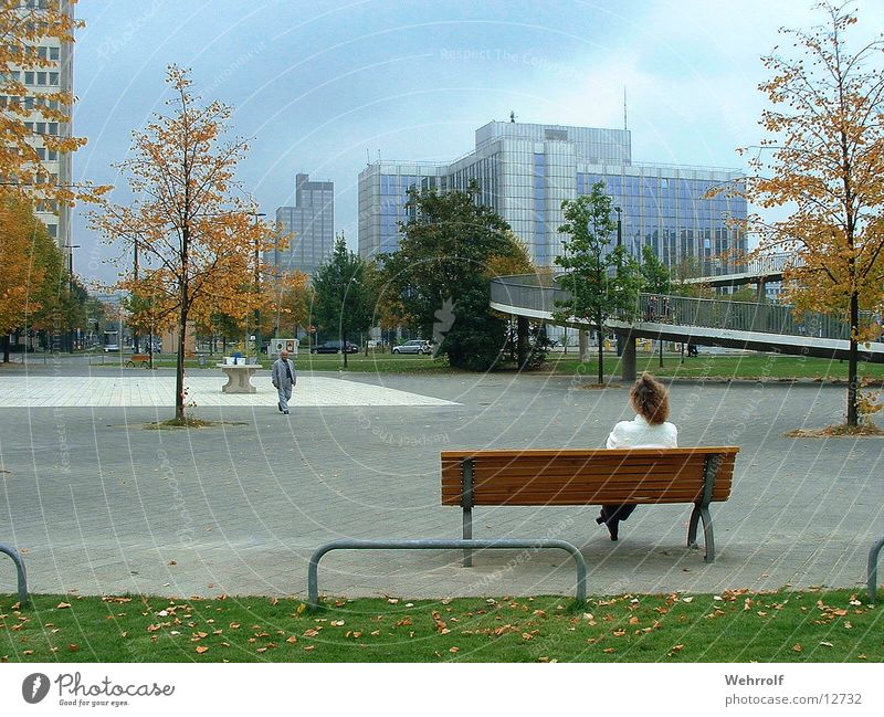 Peace and quiet in the city Woman Town Relaxation Downtown Calm Human being Bench Duesseldorf