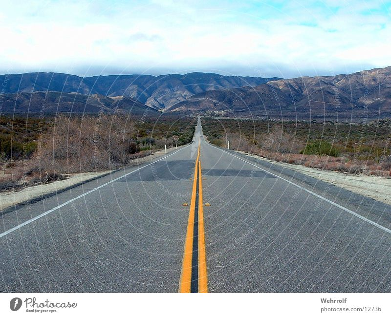 Road to nowhere Far-off places Freedom Mountain Nature Landscape Street Lanes & trails Highway Relaxation Arizona USA Exterior shot Steppe Right ahead