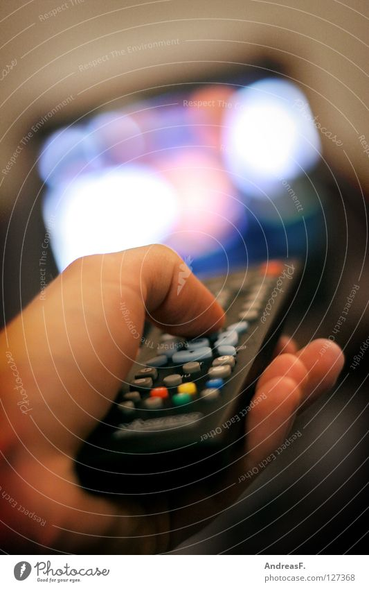 Hand Technology Media Film industry Information Television Advertising Cinema Living room Row Boredom Buttons Radio (broadcasting) Thumb Entertainment Video