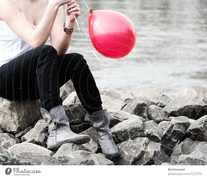 crash Summer Feminine Woman Adults Youth (Young adults) Chest Arm Hand Legs Feet River bank Pants Footwear Boots Balloon Think Sit Playing Dream Red Dreamily