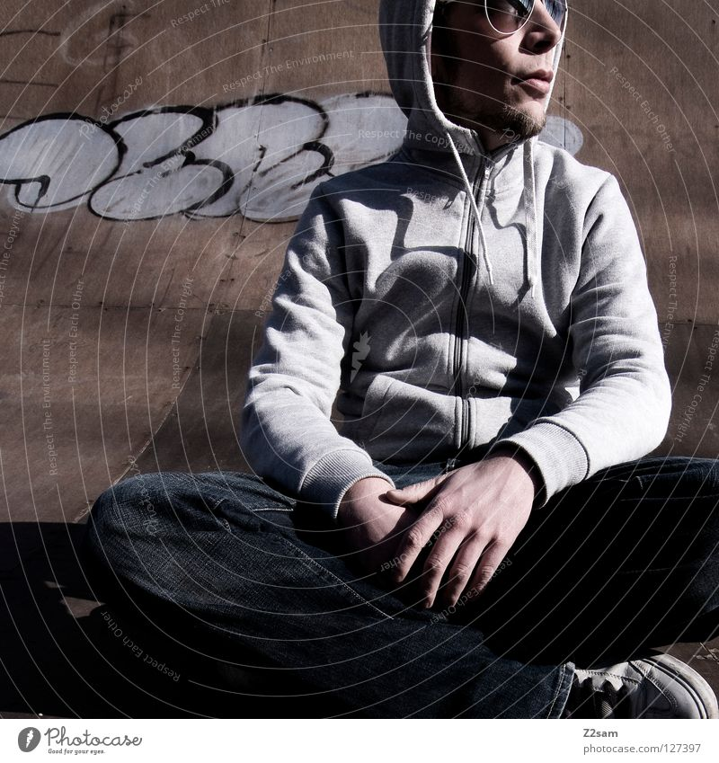 Human being Man Youth (Young adults) Relaxation Style Wood Graffiti Lighting Arm Masculine Concrete Sit Cool (slang) Jeans Gloomy Floor covering