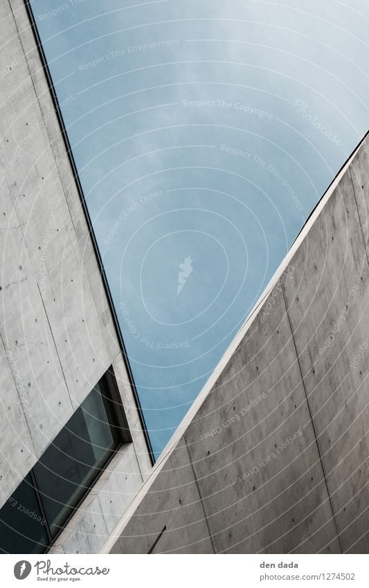 """urban letter """"V"""" Berlin Town High-rise Architecture Wall (barrier) Wall (building) Facade Window Stone Concrete Characters Aggression Sharp-edged Tall Blue Gray"""