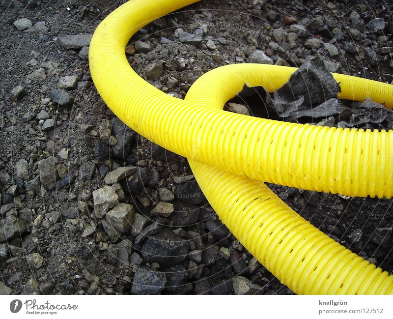 loop Yellow Gray Hose Furrow Curved Muddled Traffic infrastructure Industry Roller coaster Stone Statue Plastic Gravel
