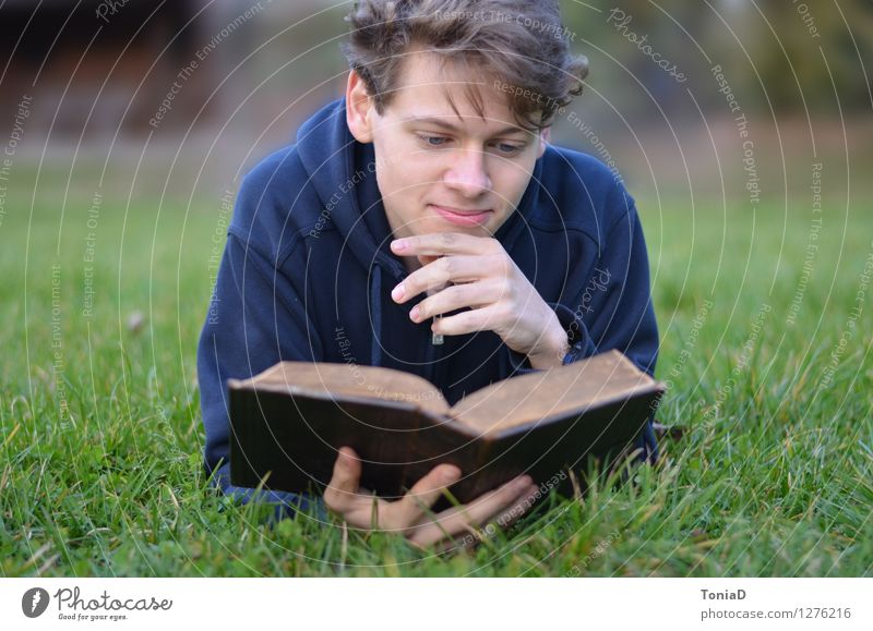 Human being Nature Youth (Young adults) Young man Calm 18 - 30 years Adults Meadow Religion and faith Lie Masculine Contentment Leisure and hobbies Study Book Reading
