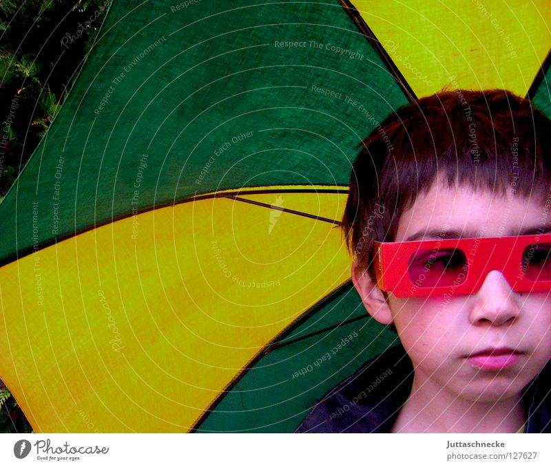 When the Rain begins to fall.... Umbrella Yellow Red Eyeglasses Sunglasses Portrait photograph April Whim Child Boy (child) Earnest Grief Safety Screen. green
