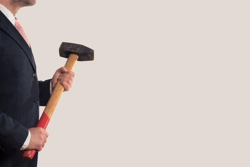 A businessman with a sledgehammer. Work and employment Profession Craftsperson Office work Construction site Economy Industry Services Stock market