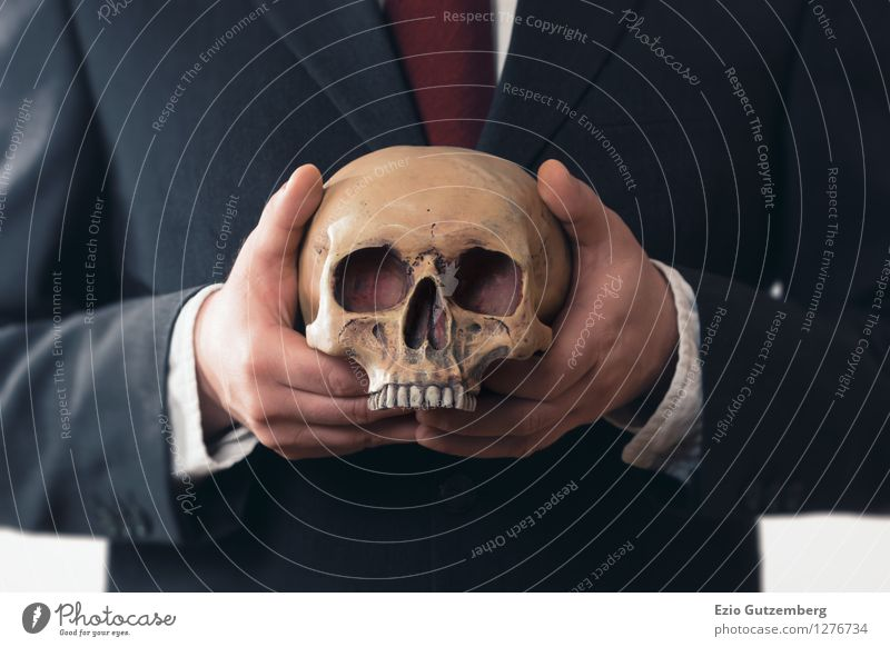 businessman with a skull in his hands Life Financial Industry Stock market Financial institution Business Company Human being Masculine Man Adults Head Hand