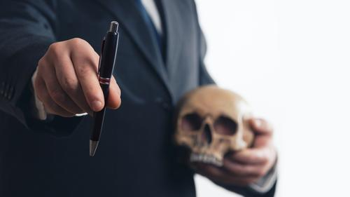 Businessman concluding contract with skull Work and employment Economy Industry Trade Services Stock market Financial institution SME Company Career Meeting