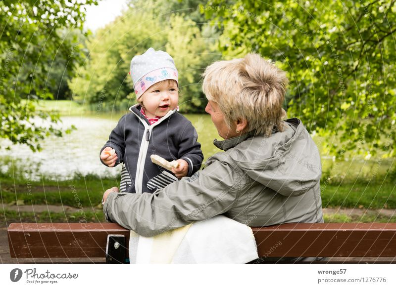 At the pond Human being Feminine Child Toddler Girl Woman Adults Female senior 2 1 - 3 years 45 - 60 years Relaxation Happiness Brown Yellow Gray Green White