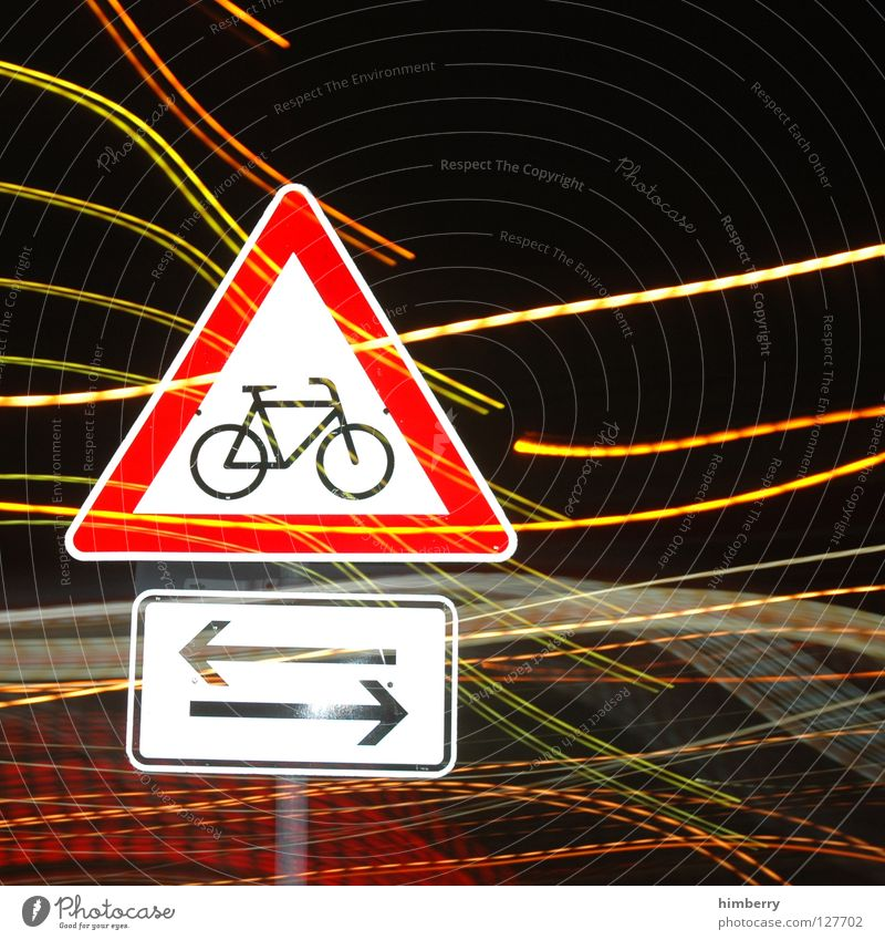 bikers crossing Lamp City life Lightning Zoom effect Exposure Long exposure Night Street sign Bicycle Stripe Transport Road traffic Urban traffic regulations