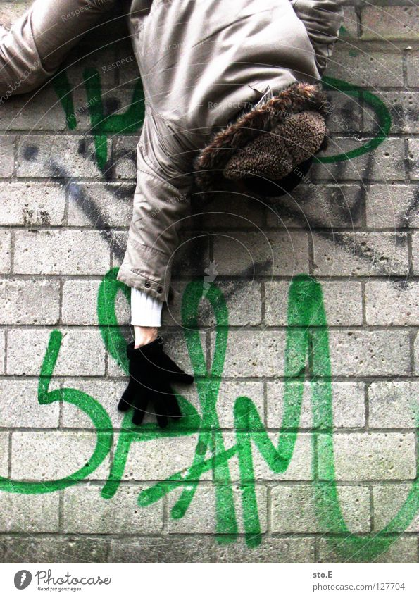 Human being Man Hand Green Black Relaxation Wall (building) Graffiti Wall (barrier) Characters Climbing Jacket Cap Traffic infrastructure Hang Word