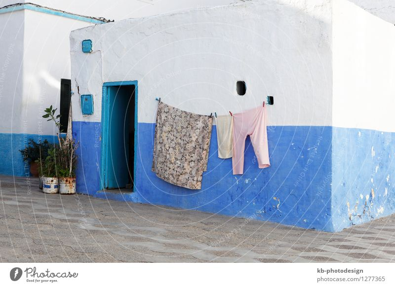 Colorful laundry hanging outside of the house Asilah Village Fishing village House (Residential Structure) Clothing Pants Headscarf Living or residing blue